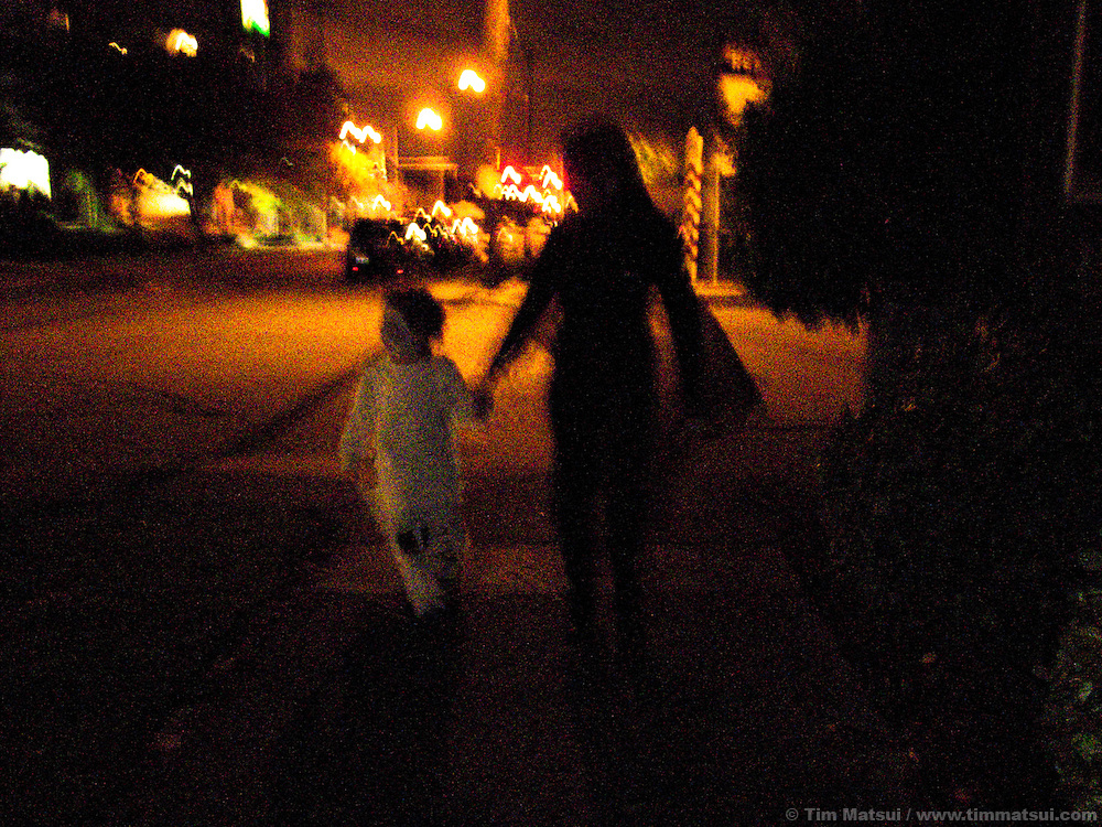 Trick or treating and halloween costumes with a child.