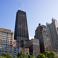Photo of Chicago skyline with the John Hancock Center building and other popular downtown Chicago city buildings. The John Hancock Center is one of the world's tallest skyscrapers and is a famous fixture in the Chicago skyline.