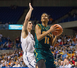 Huntington forward Dajon Congleton (10) drives to the hoop to shoot against Parkersburg South during the Class AAA championship game at the Charleston Civic Center.