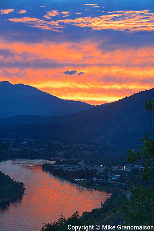 Sunset reflecting off the Columbia River in the Columbia Valley flanked by the Monashee Mountains in the West and the Selkirk Mountains in the East, Trail, British Columbia, Canada
