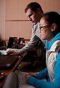 Volunteer Michael Schultz (Top) assists international student Qiory Wu of China complete her taxes at a volunteer income tax assistance program offered by the College of Business at Ohio University.