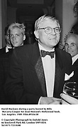 David Hockney during a party hosted by Billy McCarty-Cooper for Jean Howard's Hollywood book. Los Angeles. 1989. Film.89324/28<br />