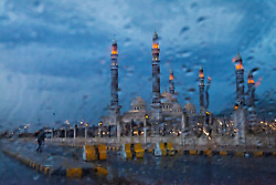 Lights atop the 300-foot minarets at the four-year-old al Saleh Mosque glow during a storm in Sana, Yemen, March 31, 2012. The $60 million house of worship is Yemen's largest and most extravagant, named for Ali Abdullah Saleh, who stepped down in February 2012 after 33 years as president. It opened with claims of promoting moderate Islam but militant groups have only gained strength here.