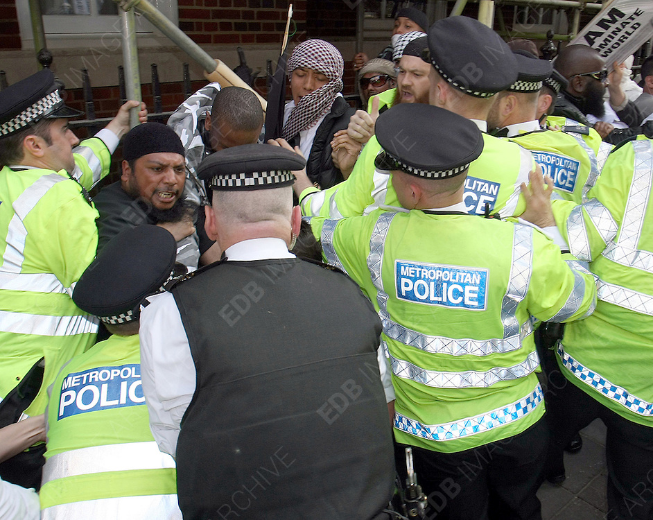 06.MAY.2011. LONDON<br /> <br /> PEOPLE CAUSING TROUBLE AND GETTING ARRESTED BY POLICE AT THE DEMONSTRATION OF MUSLIMS AGAINST BIN LADENS DEATH.<br /> <br /> BYLINE: EDBIMAGEARCHIVE.COM<br /> <br /> *THIS IMAGE IS STRICTLY FOR UK NEWSPAPERS AND MAGAZINES ONLY*<br /> *FOR WORLD WIDE SALES AND WEB USE PLEASE CONTACT EDBIMAGEARCHIVE - 0208 954 5968*