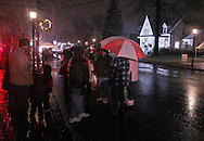 Pine Bush, NY - People stand in the street as the snow falls during the Pine Bush Festival of Lights on Dec. 5, 2009.