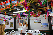 A family inside a decorated Sukkah