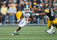 November 12, 2011: Michigan State Spartans wide receiver B.J. Cunningham (3) tries to avoid Iowa Hawkeyes linebacker Christian Kirksey (20) during the first half of the NCAA football game between the Michigan State Spartans and the Iowa Hawkeyes at Kinnick Stadium in Iowa City, Iowa on Saturday, November 12, 2011. Michigan State defeated Iowa 37-21.