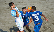 El Salvador team-mates Heber and Batres vie for the ball in their Copa Pilsener 2016 match against Argentina.