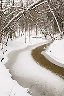 A small stream river in the Hiawatha National Forest in Michigan's Upper Peninsula in winter.