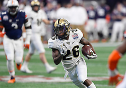 UCF Knights wide receiver Otis Anderson (26) runs for a touchdown against Auburn University during the second half of the Chick-fil-A Peach Bowl NCAA college football game at the Mercedes-Benz Stadium in Atlanta, January 1, 2018. UCF won 34-27 to go undefeated for the season. (David Tulis via Abell Images for Chick-fil-A Peach Bowl)