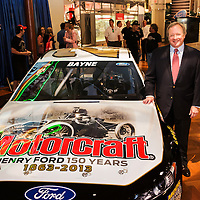 Edsel Ford II standing next to Trevor Bayne's #21 car with Henry Ford 150 year birthday commemorative paint scheme at the Henry Ford Museum. Photographed for Ford Racing by KMS Photography.
