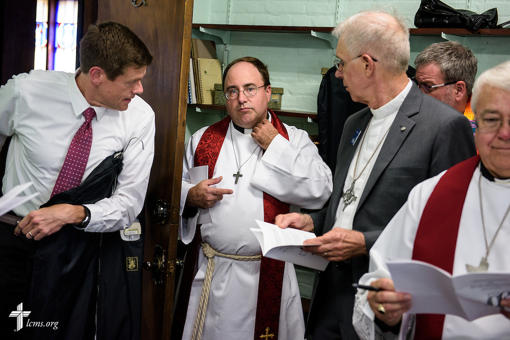 The Rev. Dr. Antonio Lopez (center), new national missionary pastor at El Calvario Lutheran Church, prepares for his installation on Sunday, July 31, 2016, at the parish in Brownsville, Texas. LCMS Communications/Erik M. Lunsford