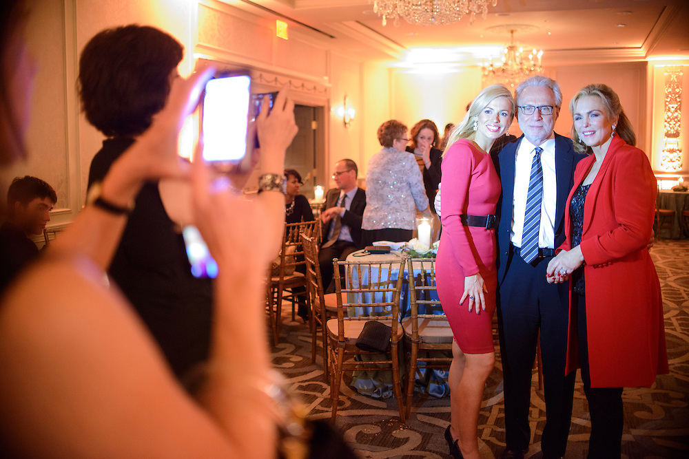 "Photo by Matt Roth.Assignment ID: 10137379A..Lynn Blitzer, foreground, makes a picture of her husband Wolf Blitzer with newscaster Pamela Brown, left, and her mother Phyliss George, Miss America 1971, right, during the end of the inaugural ""Bi-Partisan Celebration""  hosted by Buffy and Bill Cafritz, Ann and Vernon Jordan, Vicki and Roger Sant threw at the Dolley Madison Ballroom at the Madison Hotel in Washington, D.C. on Monday, January 21, 2013."