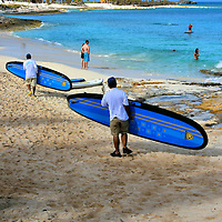 Crew Carrying Paddleboards at Great Stirrup Cay, Bahamas<br />