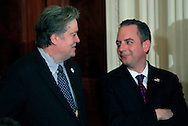 White House chief of staff Reince Priebus and  Steve Bannon talk before President Donald Trump announces his nomination federal appeals Judge Neil Gorsuch to the U.S. Supreme Court in the East Room of the White House on January 31, 2017<br /> <br /> Photo by Dennis Brack