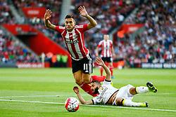 Dusan Tadic of Southampton is tackled by Rochdi Achenteh of Vitesse Arnhem - Mandatory by-line: Jason Brown/JMP - Mobile 07966386802 - 31/07/2015 - SPORT - FOOTBALL - Southampton, St Mary's Stadium - Southampton v Vitesse Arnhem - Europa League