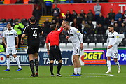 Yellow Card - Oli McBurnie (9) of Swansea City is shown a yellow card, booked by referee Keith Stroud during the EFL Sky Bet Championship match between Swansea City and Reading at the Liberty Stadium, Swansea, Wales on 27 October 2018.