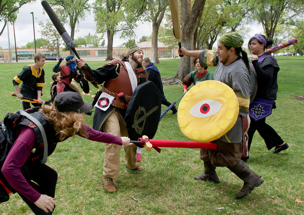 mkb042917k/metro/Marla Brose -- A group of live action role players (LARP), including Selena McWhirter, bottom left, Donny Payne, center, and Robert Reyes, right,  play a fighting game in Taylor Park, Saturday, April 29, 2017, in Albuquerque, N.M. (Marla Brose/Albuquerque Journal)