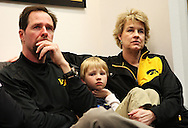 Head coach Lisa Bluder (right) sits with her husband David (left) and her son David (center) while watching the NCAA Women's Basketball Selection Show on ESPN in their locker room at Carver-Hawkeye Arena in Iowa City on Monday March 16, 2009.