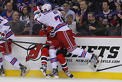 Jan 31; Newark, NJ, USA; New York Rangers left wing Mike Rupp (71) hits New Jersey Devils right wing David Clarkson (23) during the first period at the Prudential Center.