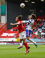 Lawrie Wilson of Charlton Athletic (L) is challenged by Adam Le Fondre of Reading (R) during the Sky Bet Championship match at The Valley, London<br /> Picture by Andrew Tobin/Focus Images Ltd +44 7710 761829<br /> 05/04/2014