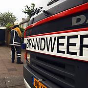 Garagebrand Gemeenlandslaan 1 Huizen