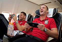 CARDIFF, WALES - Monday, September 4, 2017: Wales' Sam Vokes and Andy King play Mario Kart on the Nintendo Switch on the team plane as the squad depart Cardiff Airport to travel to Chișinău ahead of the 2018 FIFA World Cup Qualifying Group D match against Moldova. (Pic by David Rawcliffe/Propaganda)