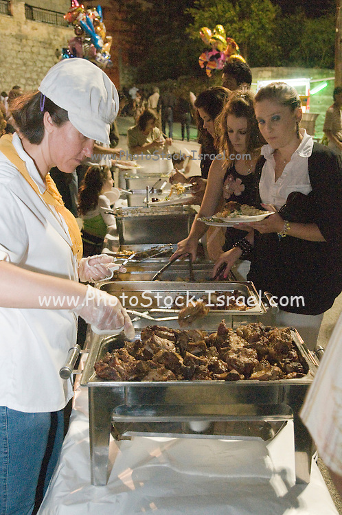 Cyprus, Lysos, A typical Cypriot Greek wedding in the town square all are invited. Three thousand people from the village and near by villages were expected. The self-service food buffet .