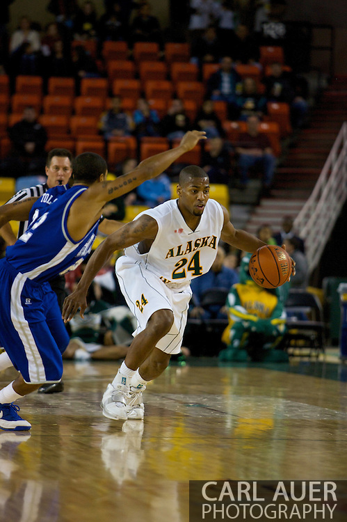 November 26, 2008: University of Alaska-Anchorage guard Kenny Barker (24) drives in the first half against Hampton in the opening game of the 2008 Great Alaska Shootout at the Sullivan Arena.