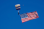 USA, Oregon, Hillsboro, USAF Academy skydiver, diving with the US Flag.
