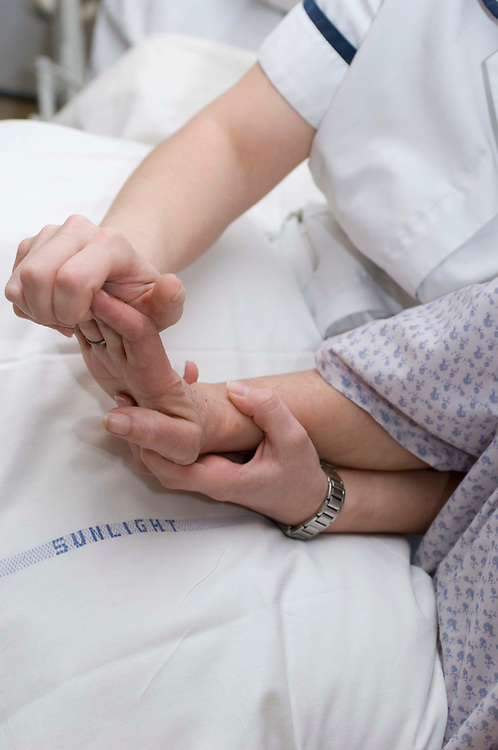 Physiotherapy on a patient's hand