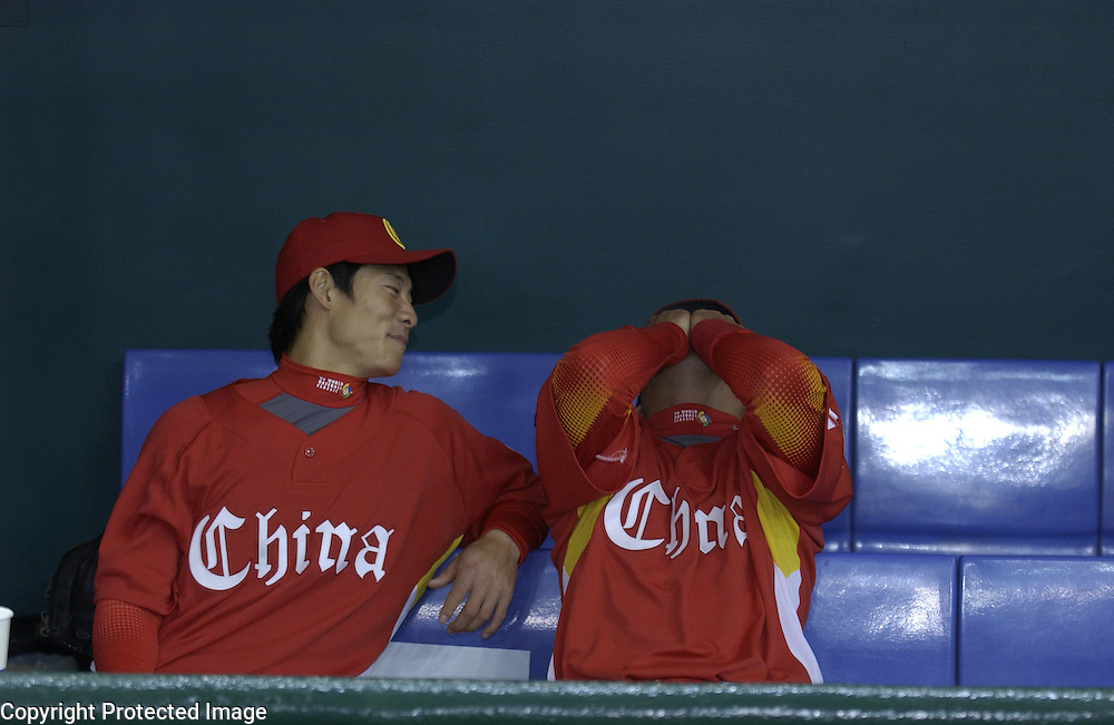 Team China players having a laugh in the dugout before the start of Game 5 against Team Chinese Taipei in the World Baseball Classic at Tokyo Dome, Tokyo, Japan.