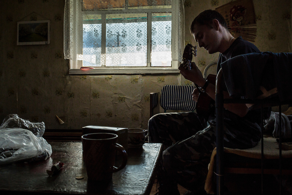 Vadim Kovalenko plays a guitar at his dacha on Sunday, October 27, 2013 in Baikalsk, Russia.
