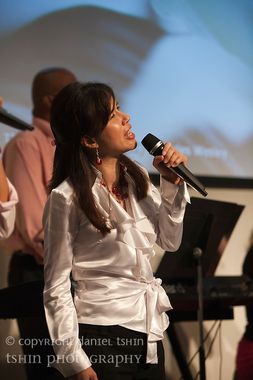 Vocalist Catherine Harsono of the worship team leading the Evangelical Church of Bangkok (ECB) during the Easter service on 24 April 2011 in Bangkok, Thailand