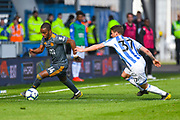 Ricardo Pereira of Leicester City (14) and Eric Durm of Huddersfield Town (37) in action during the Premier League match between Huddersfield Town and Leicester City at the John Smiths Stadium, Huddersfield, England on 6 April 2019.