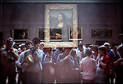 Visitors to the Louvre, in Paris, view The Mona Lisa which is housed in a protective case. ©Ed Hille/ Picturedesk.net ©Ed Hille/Picturedesk.Net.ONE TIME USE ONLY.
