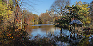 The Lake and Wagner Cove with its rustic boatlanding in Central Park, New York City.