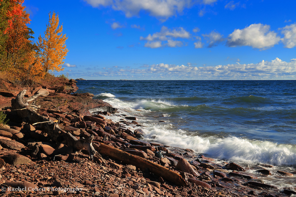 &quot;Red Stones and Waves&quot; <br /> <br /> Such a gorgeous day on at Presque Isle Park! Colorful fall trees, blue skies, waves on Lake Superior, and beautiful red hued stones on the shore!