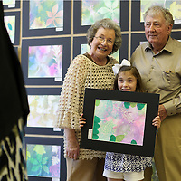 Adam Robison | BUY at PHOTOS.DJOURNAL.COM<br /> Blake bevill, a first grader at Mooreville Elementary School, holds her painting as she has her picture made with her grandparents Billy and Ann Bevill, from New Albany.