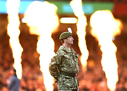A solider pitchside during the minutes silence fan during the Autumn International match at the Principality Stadium, Cardiff.