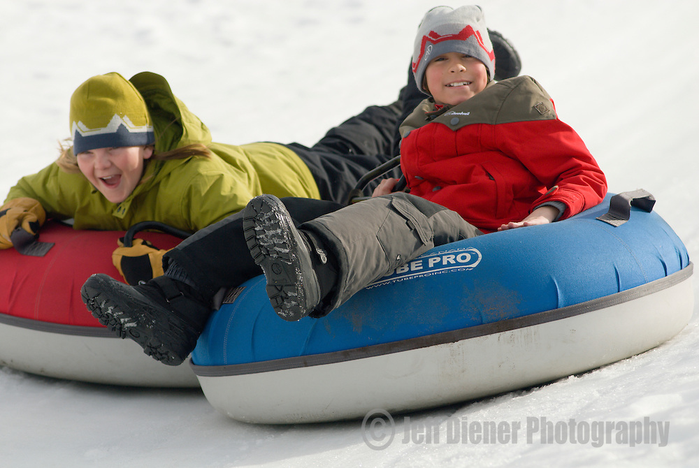 Two boys go snow tubing at Snow King Mountain in Jackson, Wyoming.