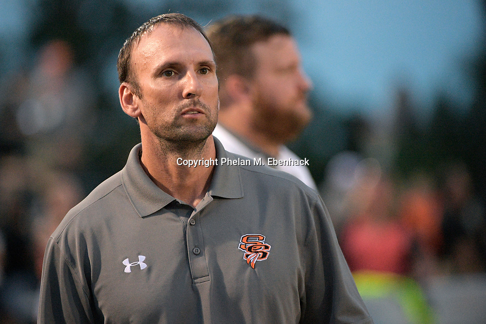 Seminole head coach Don Stark watches from the sideline during the first half of a high school football game against Lyman Friday, Oct. 6, 2017, in Sanford, Fla. (Photo by Phelan M. Ebenhack)