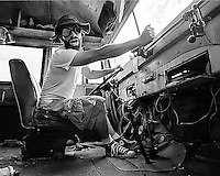 Black and White Fine art portrait of Brad at the wheel of a vintage school bus. Portrait shot on film by Kansas City art photographer Kirk Decker.