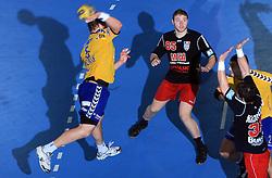Rok Praznik (5) and Andrei Dan Savenco (85) at handball match of 4th Round of EHF Men Championsleague between RK Cimos Koper (SLO) and Steaua MFA Bucuresti (ROM), in Arena Bonifika, Koper, Slovenia, on November 8, 2008. Steaua  won the match 30:29.