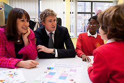 © Licensed to London News Pictures. 09/10/2013. London, UK. Tristram Hunt, the Shadow Secretary of State for Education, and Rachel Reeves, the Shadow Work and Pensions Secretary, interact with pupils during a visit  to a children's breakfast club at Richard Atkins Primary School in Brixton, London, today (09/10/2013). The visit marks the first for the two politicians who were appointed to their shadow cabinet positions on Monday this week (14/10/13). Photo credit: Matt Cetti-Roberts/LNP