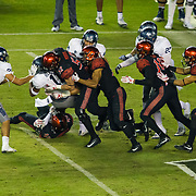 18 November 2017:  The San Diego State football team hosts Nevada Saturday night. San Diego State Aztecs linebacker Tyler Morris (52) tackles Nevada Wolf Pack kick returner Daiyan Henley (11) on kick off return in the third quarter. The Aztecs beat the Wolf Pack 42-23 at SDCCU stadium. <br /> www.sdsuaztecphotos.com