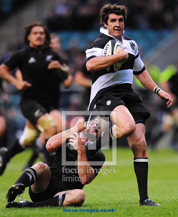 London - Saturday, December 5th 2009: Brendan Leonard of New Zealand tries to bring down Jacque Fourieand of Barbarians  during the game at Twickenham, London. ..(Pic by Alex Broadway/Focus Images)