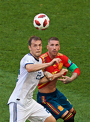 MOSCOW, RUSSIA - Sunday, July 1, 2018: Russia's Artem Dzyuba (left) and Spain's Sergio Ramos during the FIFA World Cup Russia 2018 Round of 16 match between Spain and Russia at the Luzhniki Stadium. (Pic by David Rawcliffe/Propaganda)