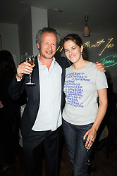 CARL FREEDMAN and TRACEY EMIN at a party to celebrate the 10th anniversary of Counter Editions the contemporary art website held at Rivington Grill, Shoreditch, London on 5th May 2010.