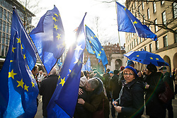© Licensed to London News Pictures. 26/01/2019. Manchester, UK. EU flags held aloft in St Peter's Square . A cross party demonstration by hundreds of supporters of a People's Vote on Britain's membership of the EU is held in St Peters Square , followed by a march to the Mechanics Institute and rally of supporters . Photo credit: Joel Goodman/LNP